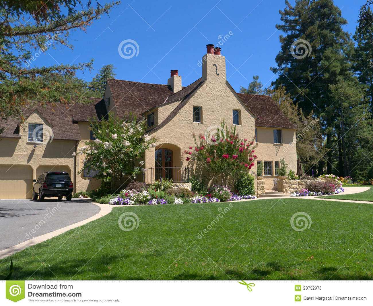 Luxury house with wide driveway and front lawn royalty for Free luxury home images