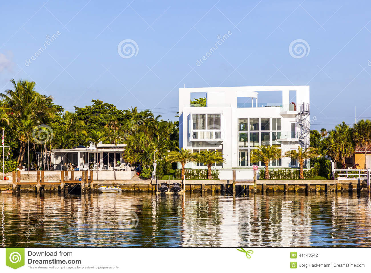 Luxury houses at the canal in miami editorial photography for Luxury home builders usa