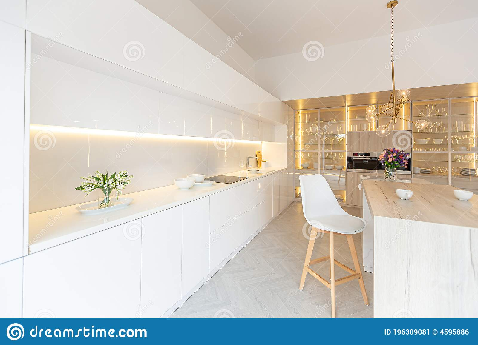 Image of: Luxury Interior Design Of Modern Trendy Snow White Kitchen In Minimalistic Style With Island And Two Bar Stools Huge Windows To Stock Image Image Of Light Design 196309081