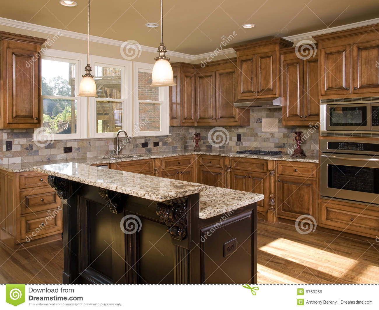 Luxury kitchen two tier island stock photo image 6769266 for Square shaped kitchen designs