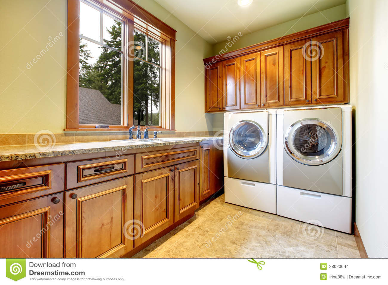 Luxury Laundry Room With Wood Cabinets Stock Photo