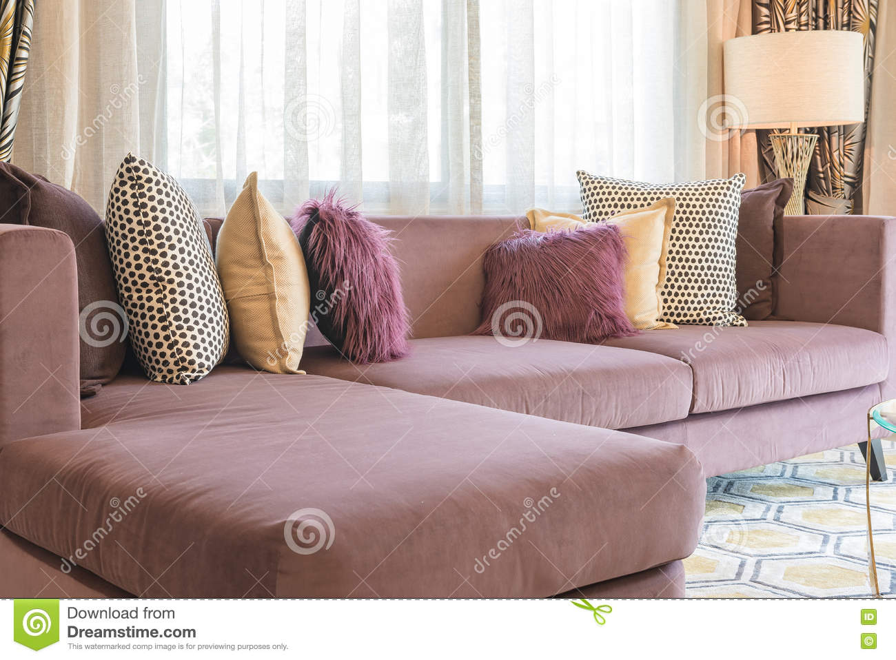 Luxury living room design with purple sofa and set of pillows