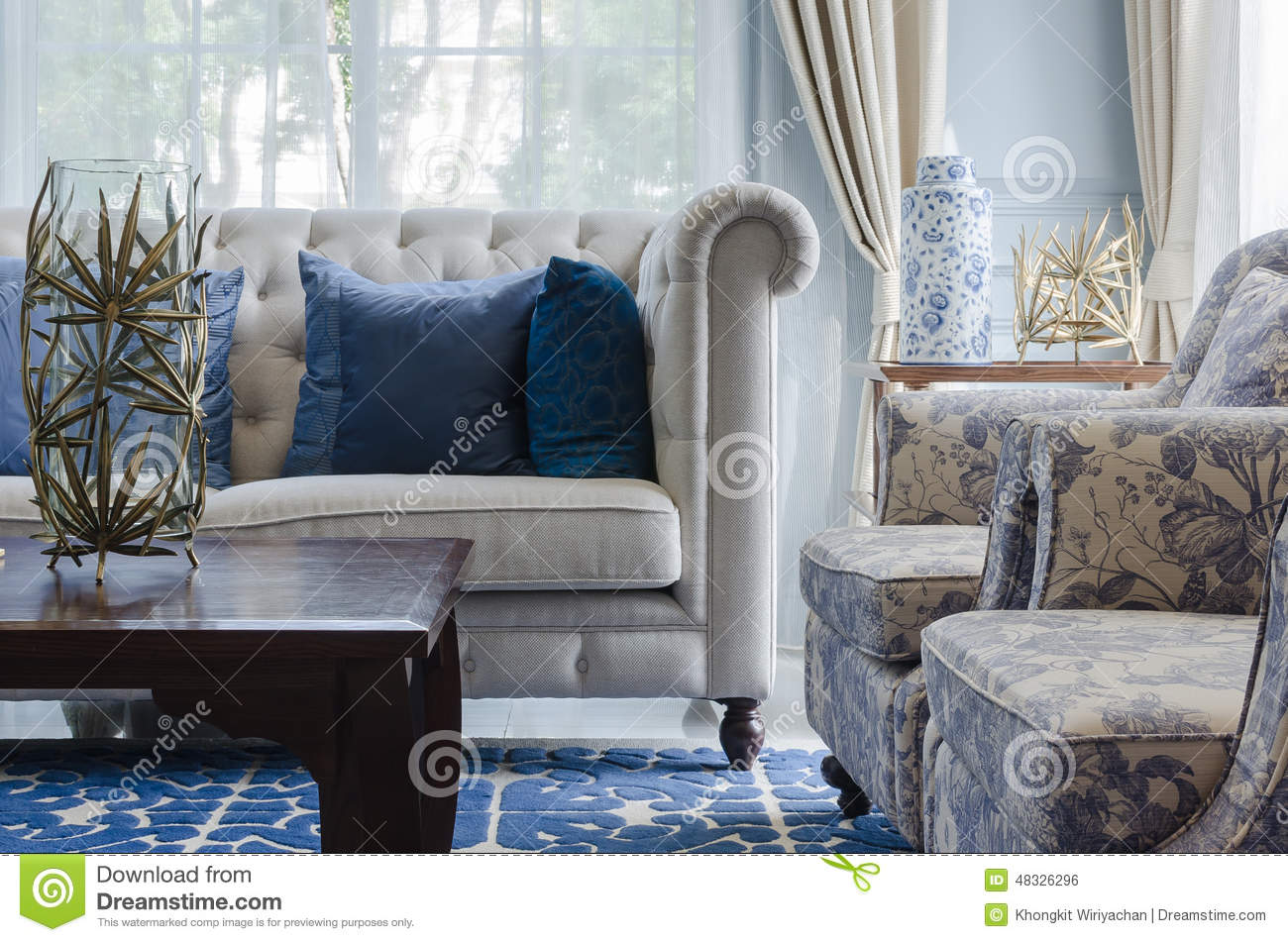 Luxury Living Room Furniture Luxury Living Room With Sofa On Blue Pattern Carpet At Home Stock