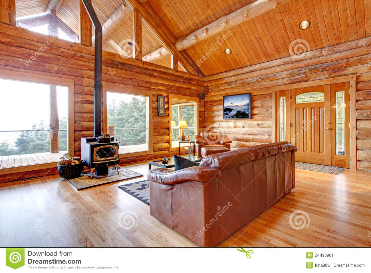 luxury log cabin living room with leather sofa  stock