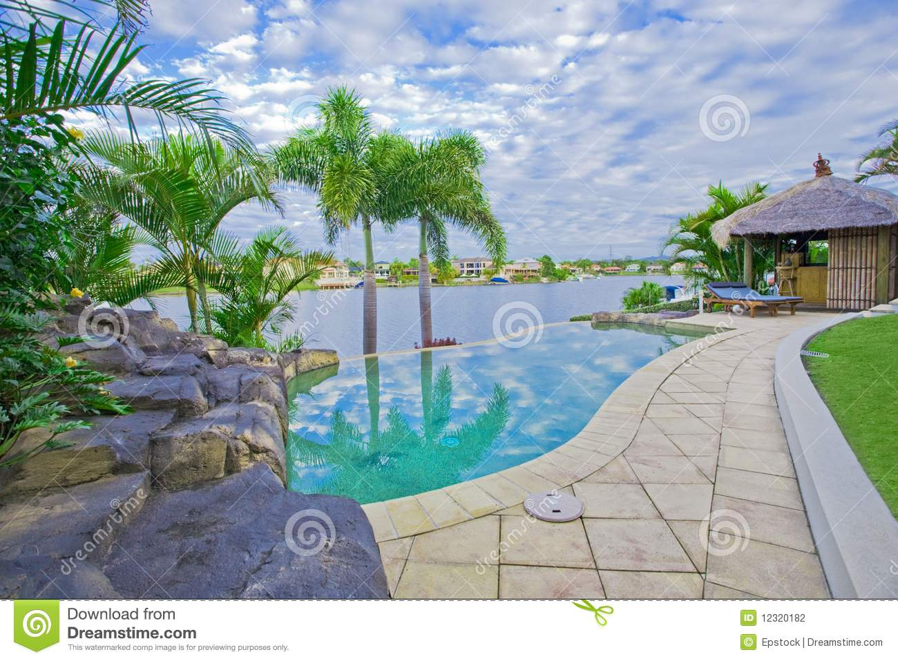 Beach house plans beach home plans beach house plan - Luxury Mansion Outside Deck With Bali Hut Stock