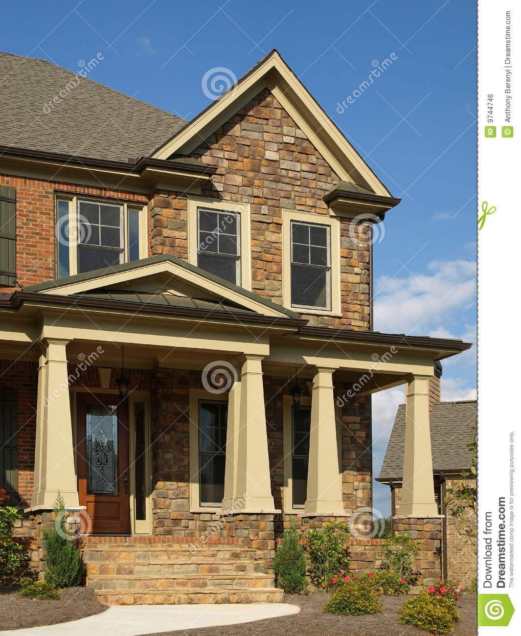 Luxury Model Home Exterior Column Entrance Stock Photo