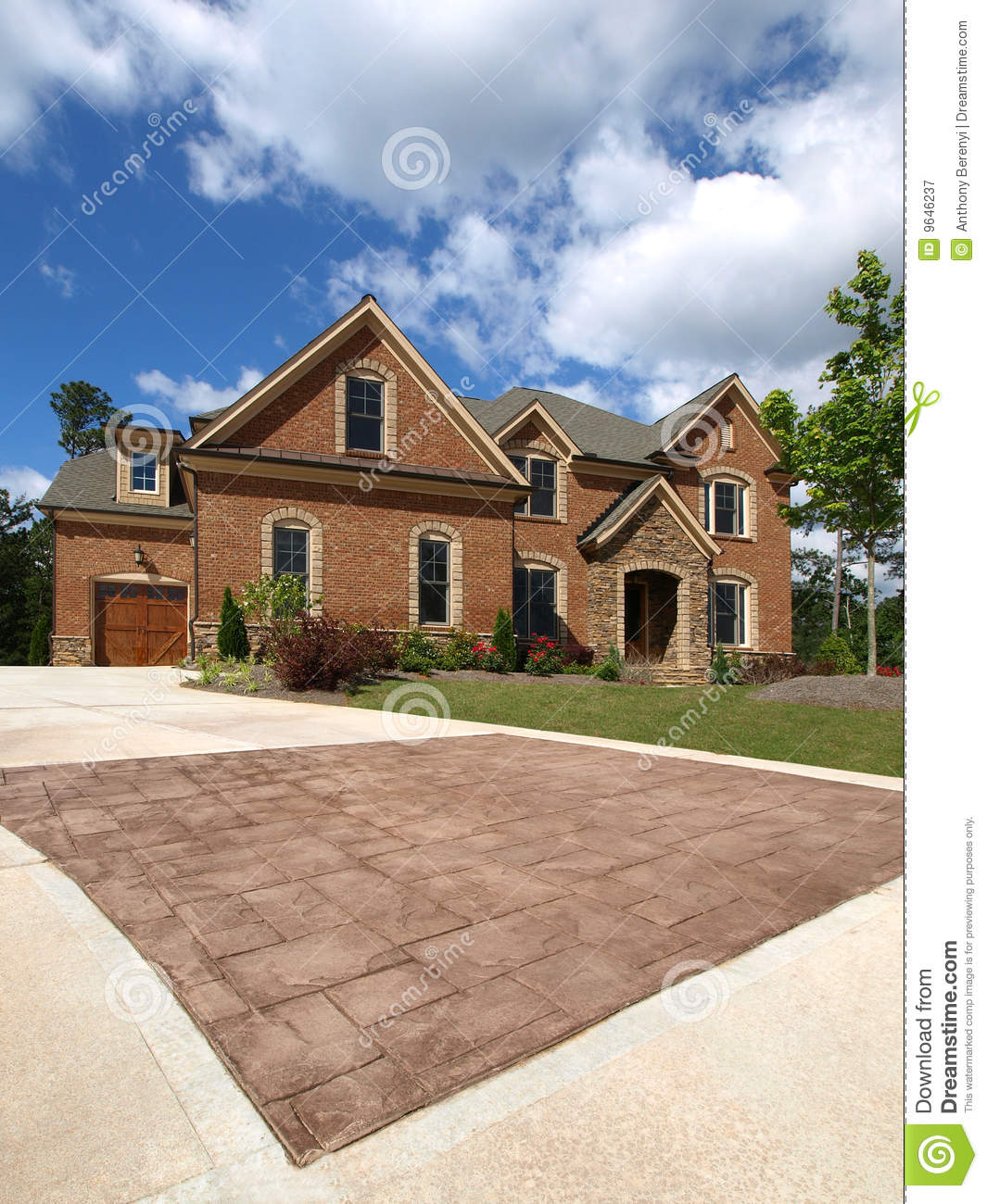 Luxury model home exterior stone driveway royalty free for Model home exterior photos