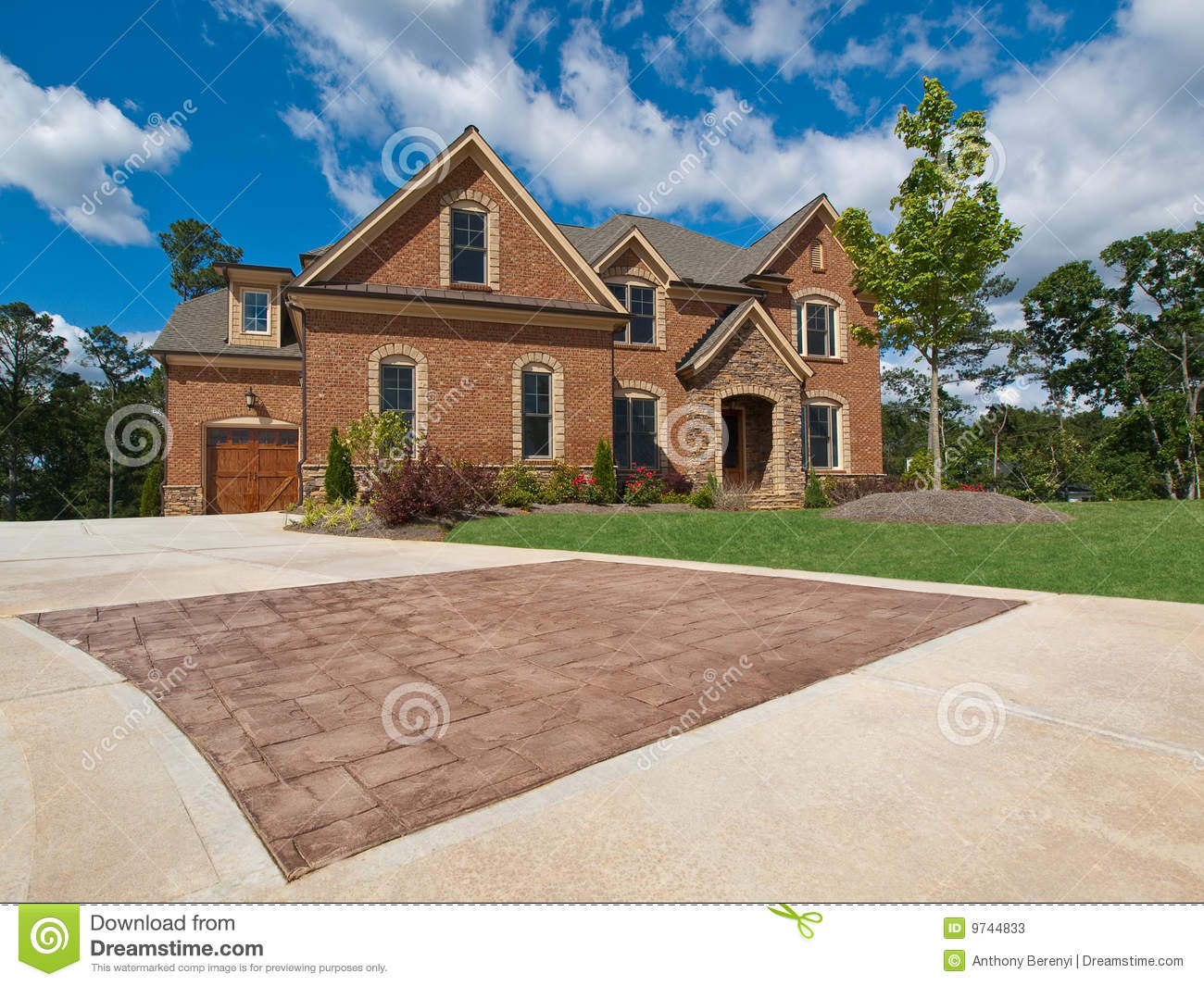 Luxury model home exterior stone driveway stock image for Model home exterior photos