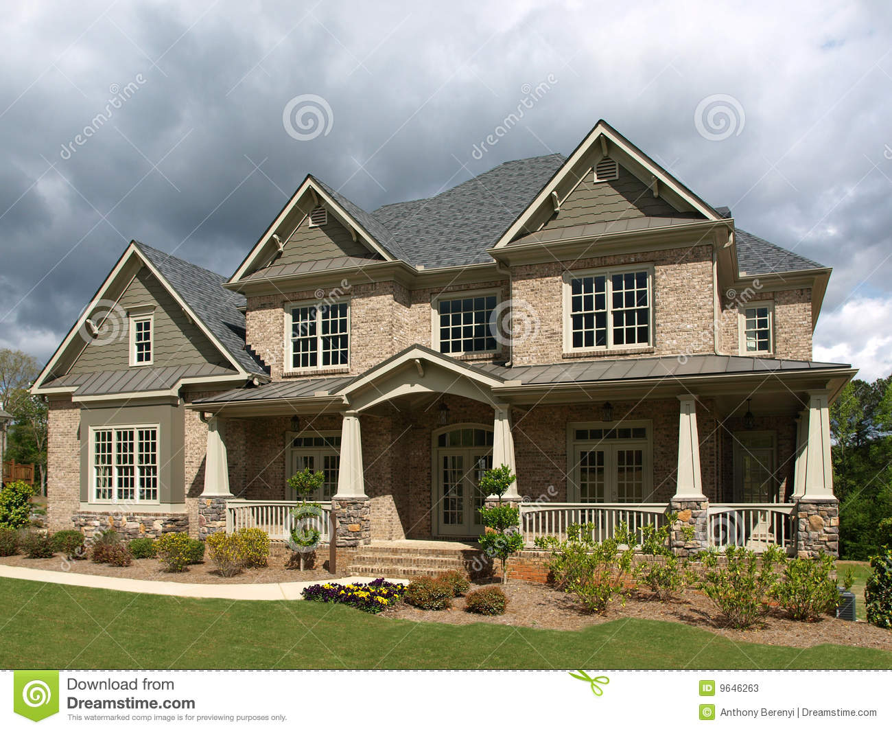 Luxury model home exterior stormy weather stock photos for Luxury home exteriors