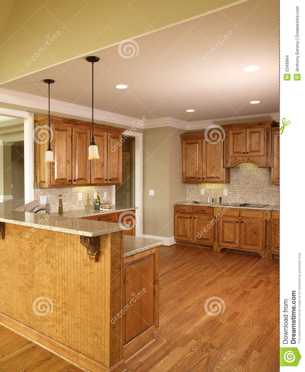 Luxury model home honey kitchen 3 stock images image for Model home kitchen images