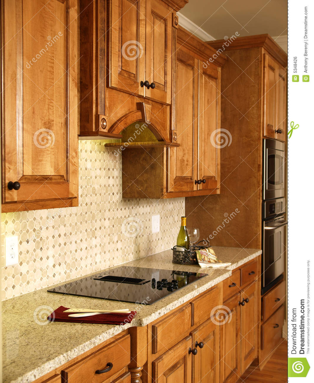 Luxury Model Home Honey Kitchen Cabinets Royalty Free