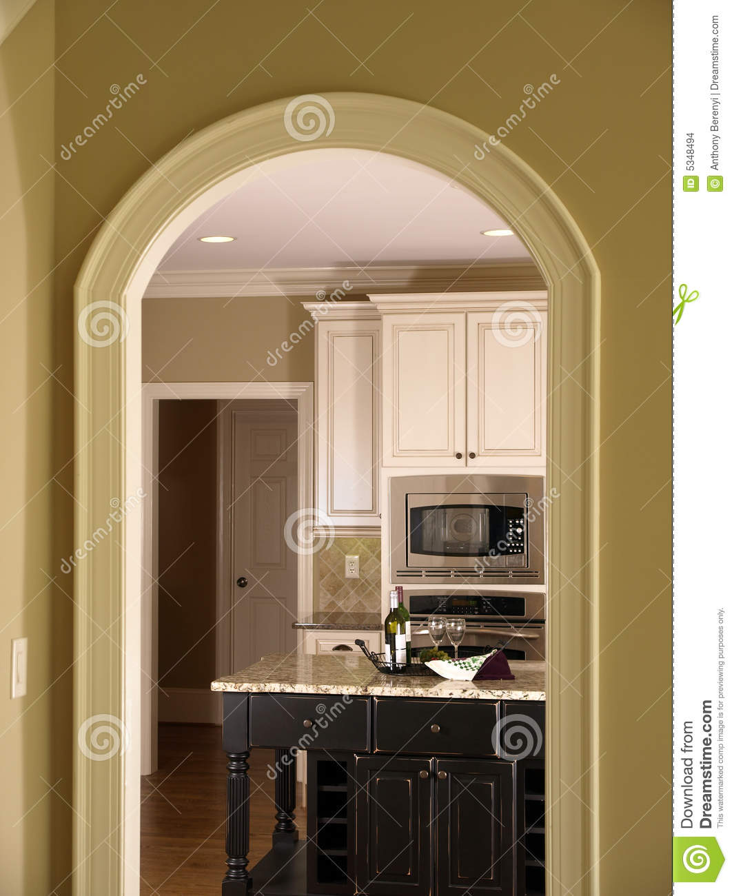 Luxury Model Home Kitchen Through Arch Door 2 Stock Photo