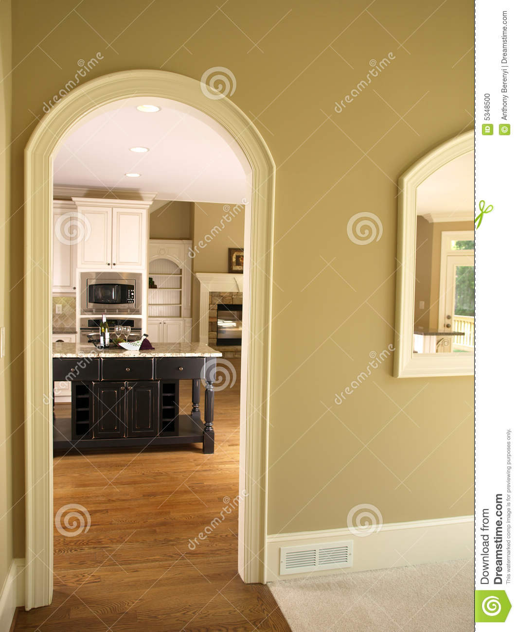 Luxury model home kitchen arch door