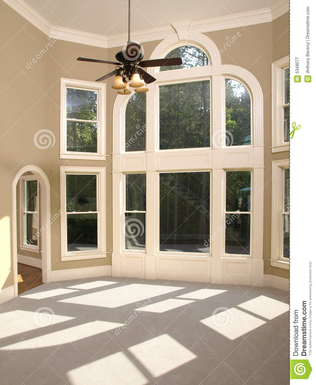 Luxury model home living room arched window wall royalty for Luxury home windows