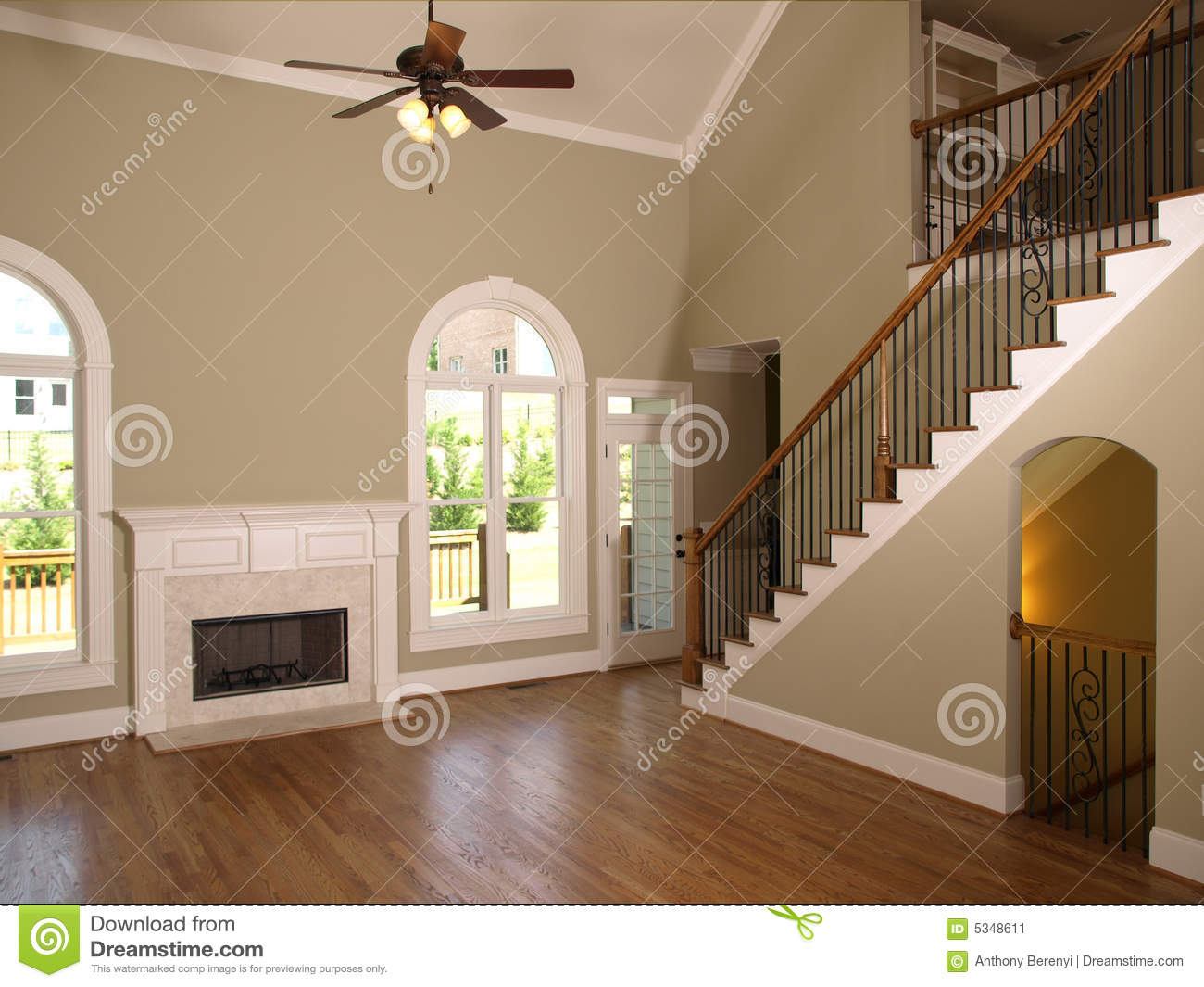 Luxury model home living room staircase stock image for Modelos de salas de estar para casas