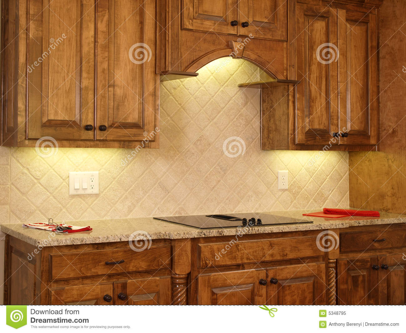kitchen in luxury home with oak cabinets stock photo   Luxury Model Home Maple Kitchen Cabinets 2 Stock Image ...
