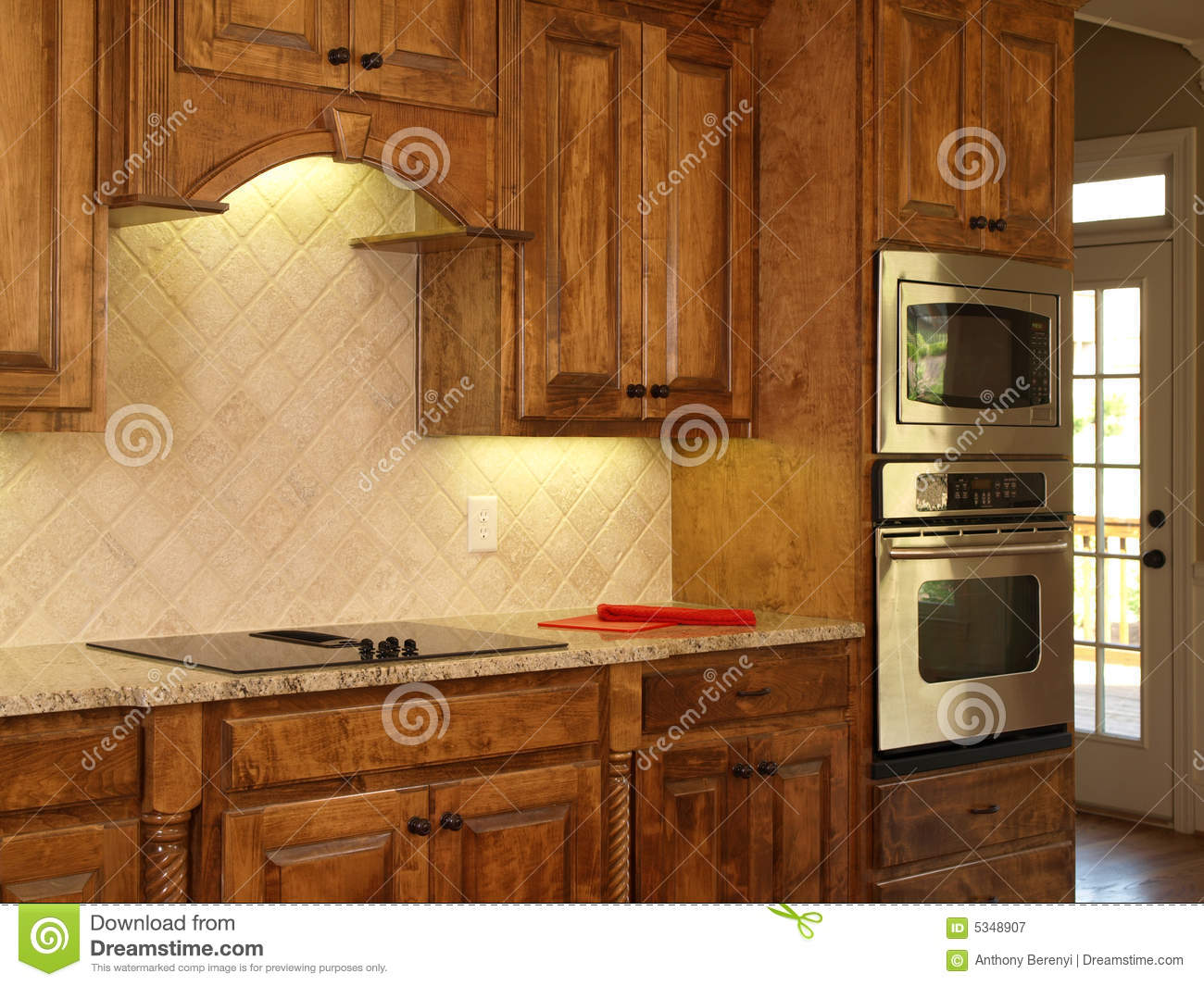 Luxury model home maple kitchen cabinets royalty free for Kitchen cabinets models