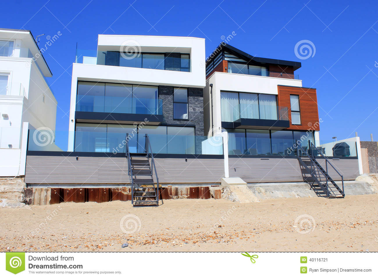 Luxury modern beach homes stock image. Image of sunny - 40116721 on modern cottages, contemporary homes, modern gated homes, coastal homes, modern home homes, modern park homes, modern alexander homes, modern home texture, modern celebrity homes, modern water homes, beautiful caribbean homes, miami modern homes, mid century modern homes, modern hut homes, modern apartments, modern mountain homes, luxury homes, modern mansions, modern winter homes, modern box homes,