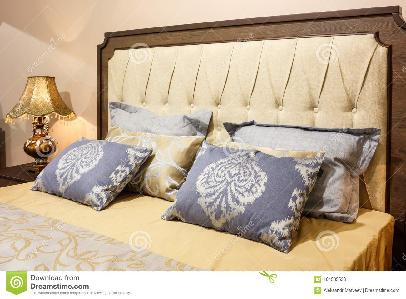 Luxury modern style bedroom in yellow and blue tones, Interior of a hotel bedroom, cushions with a pattern ornament
