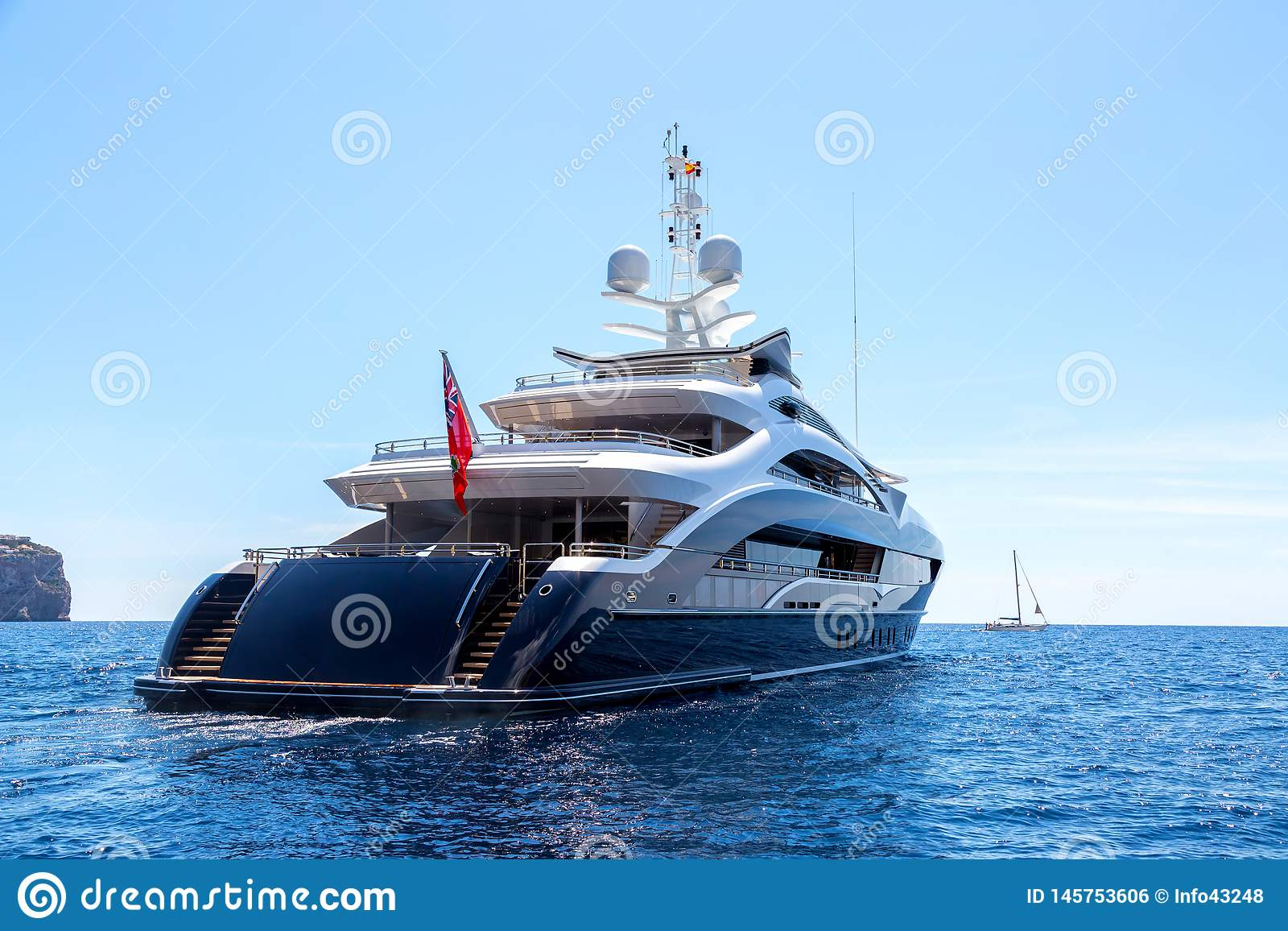 Luxury motor yacht, rear view, sailing on the sea