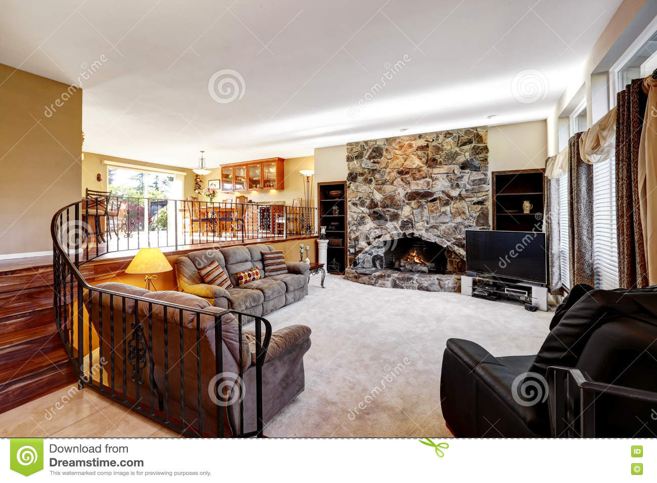 Luxury Open Living Room Interior With Stone Fireplace