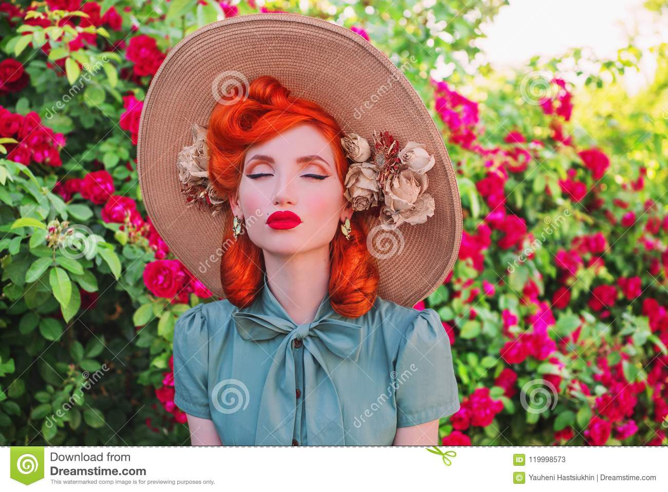 Luxury Retro Girl With Red Lips In Mint Dress On A Beautiful Flower