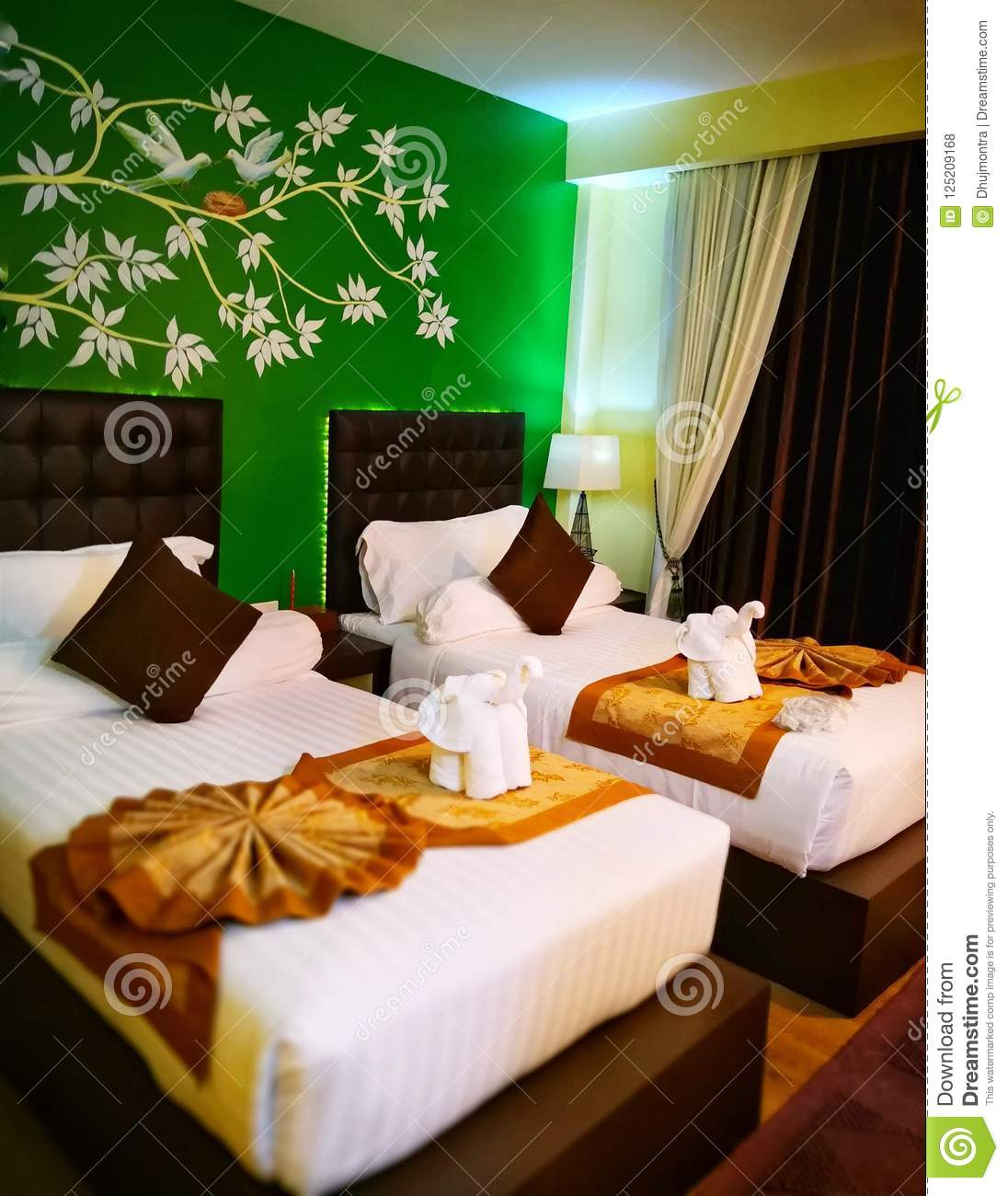 Luxury room with twin beds with colorful and fabric art decoration