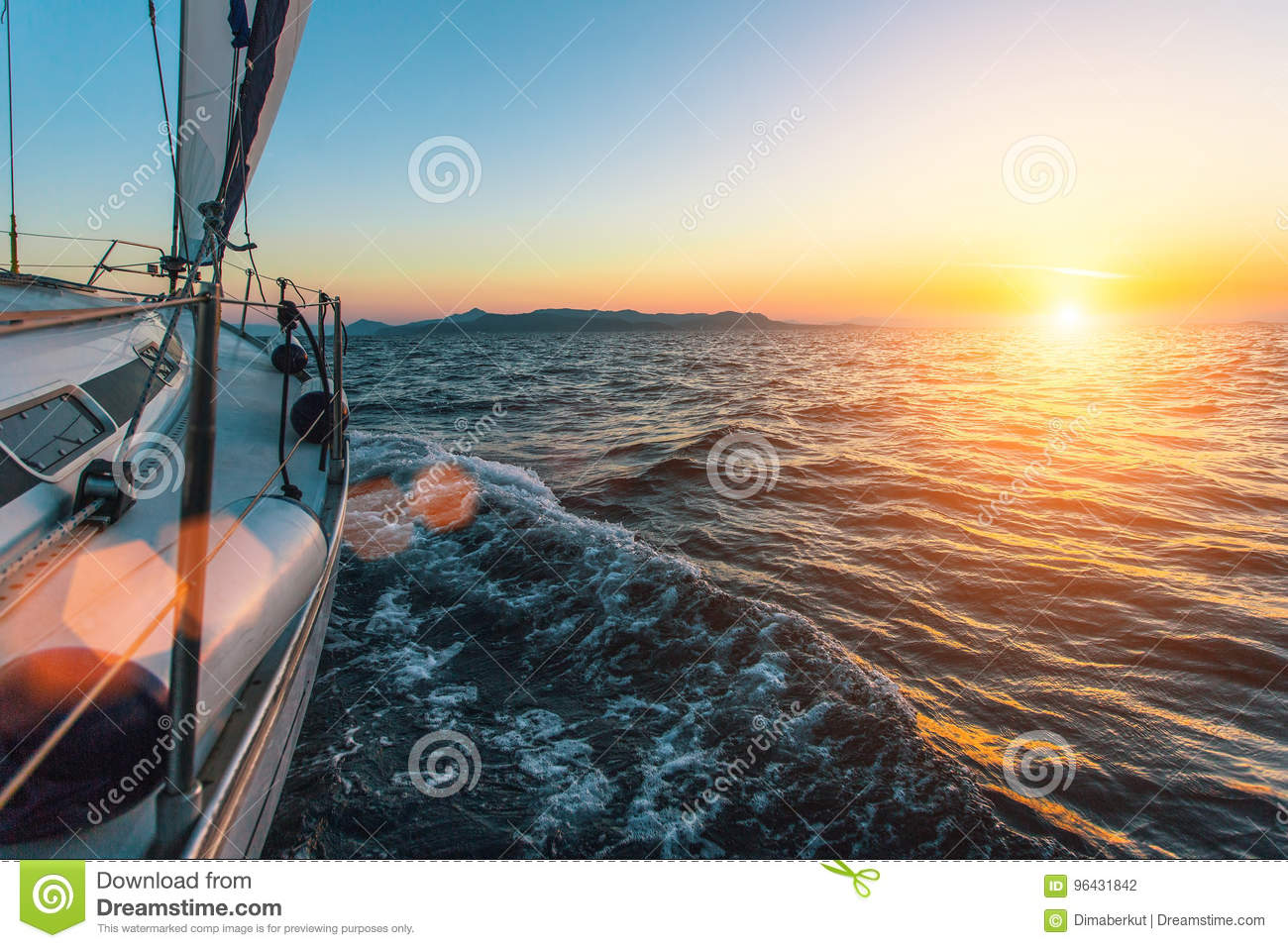 Luxury sailing ship yacht boat in the Aegean Sea during beautiful sunset. Nature.
