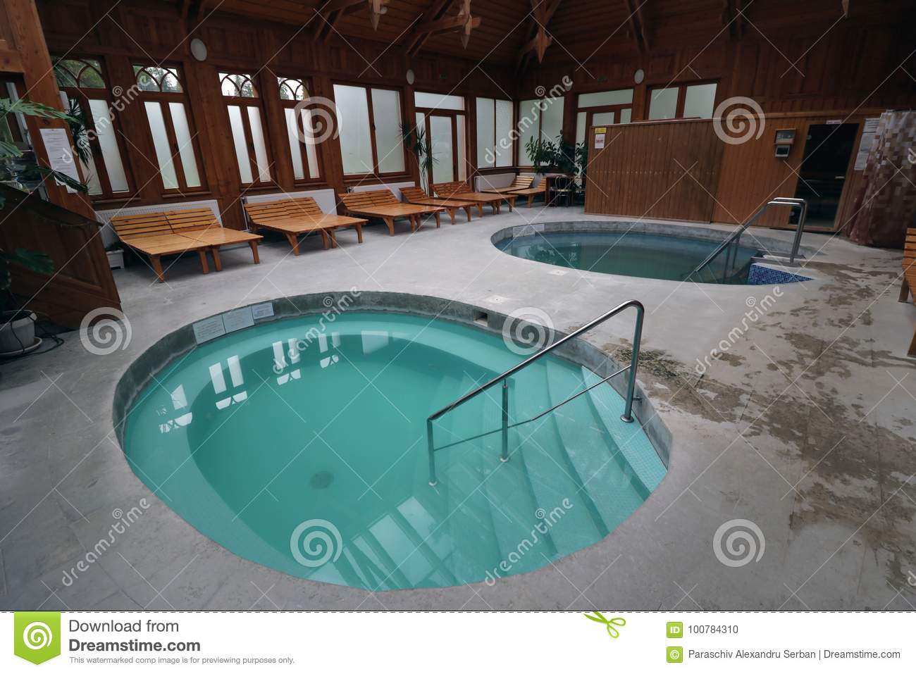Outdoor Natural Gas Fire Pit Table, Luxury Spa Interior With Swimming Pools Blue Water Wooden Walls And Lounge Chairs Stock Photo Image Of Luxury Pools 100784310