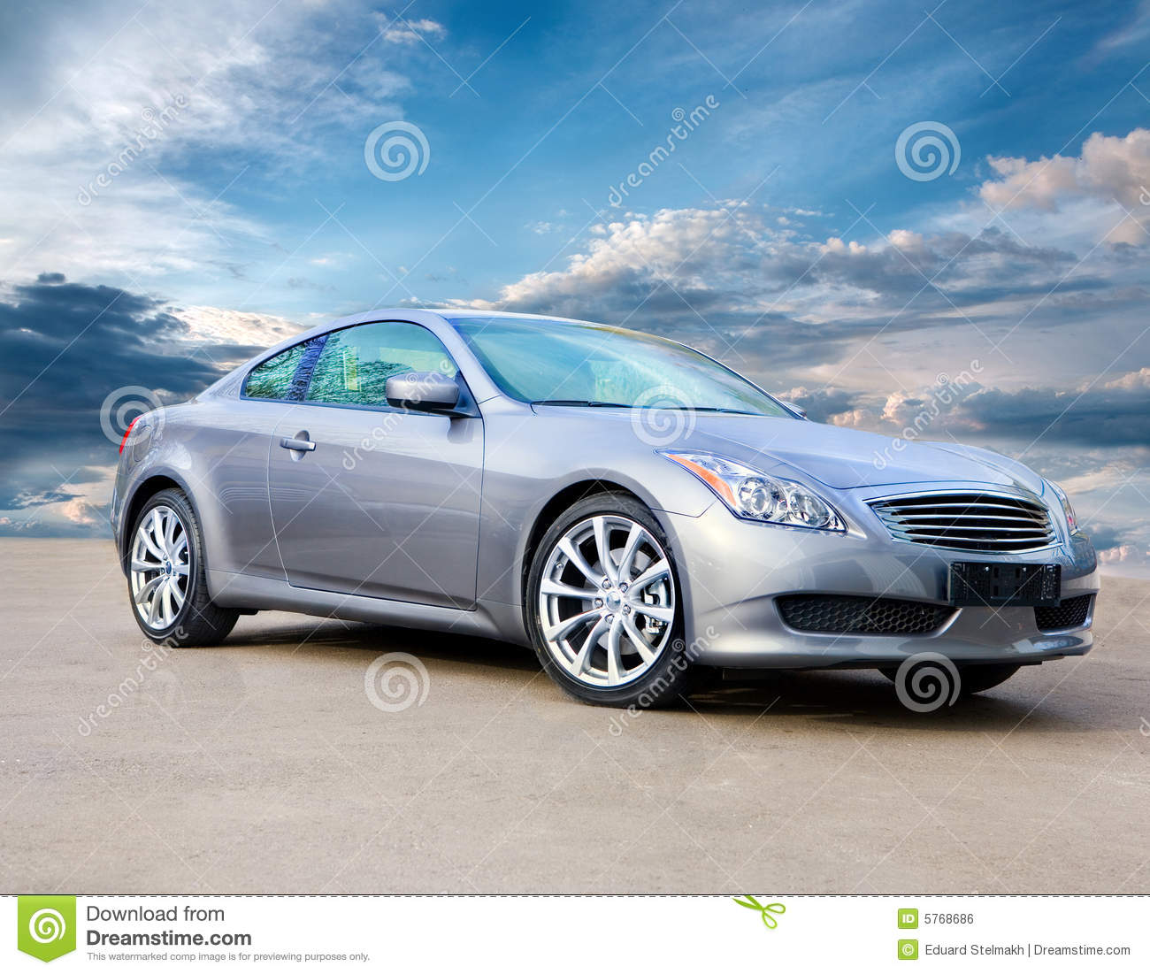 Luxury Sports Car Against Bright Cloudy Sky Royalty Free