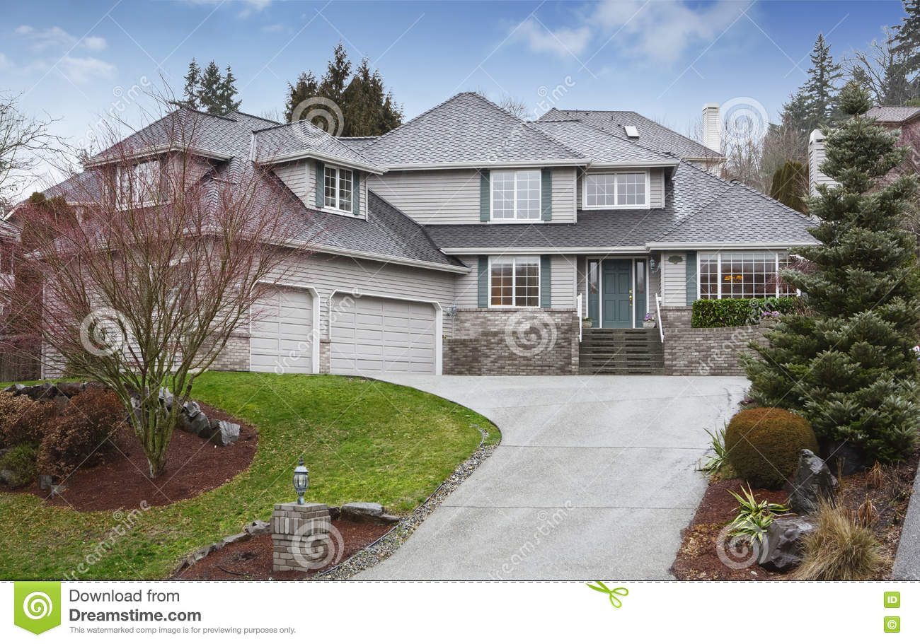 Luxury house view of garage and driveway royalty free for Free luxury home images