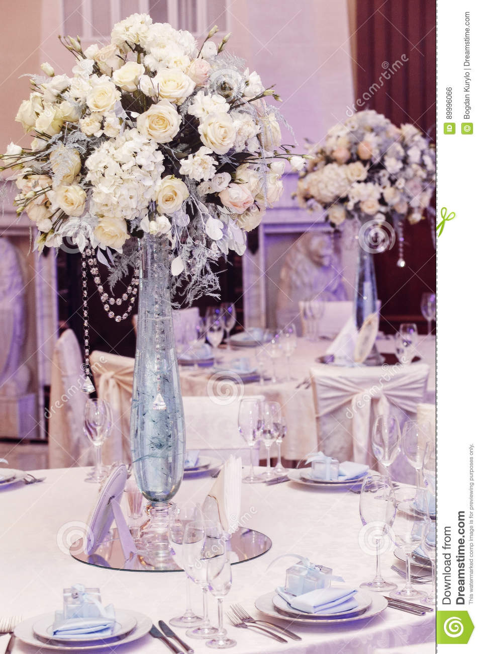 Luxury Wedding Decor With Flowers And Glass Vases With Jewels On