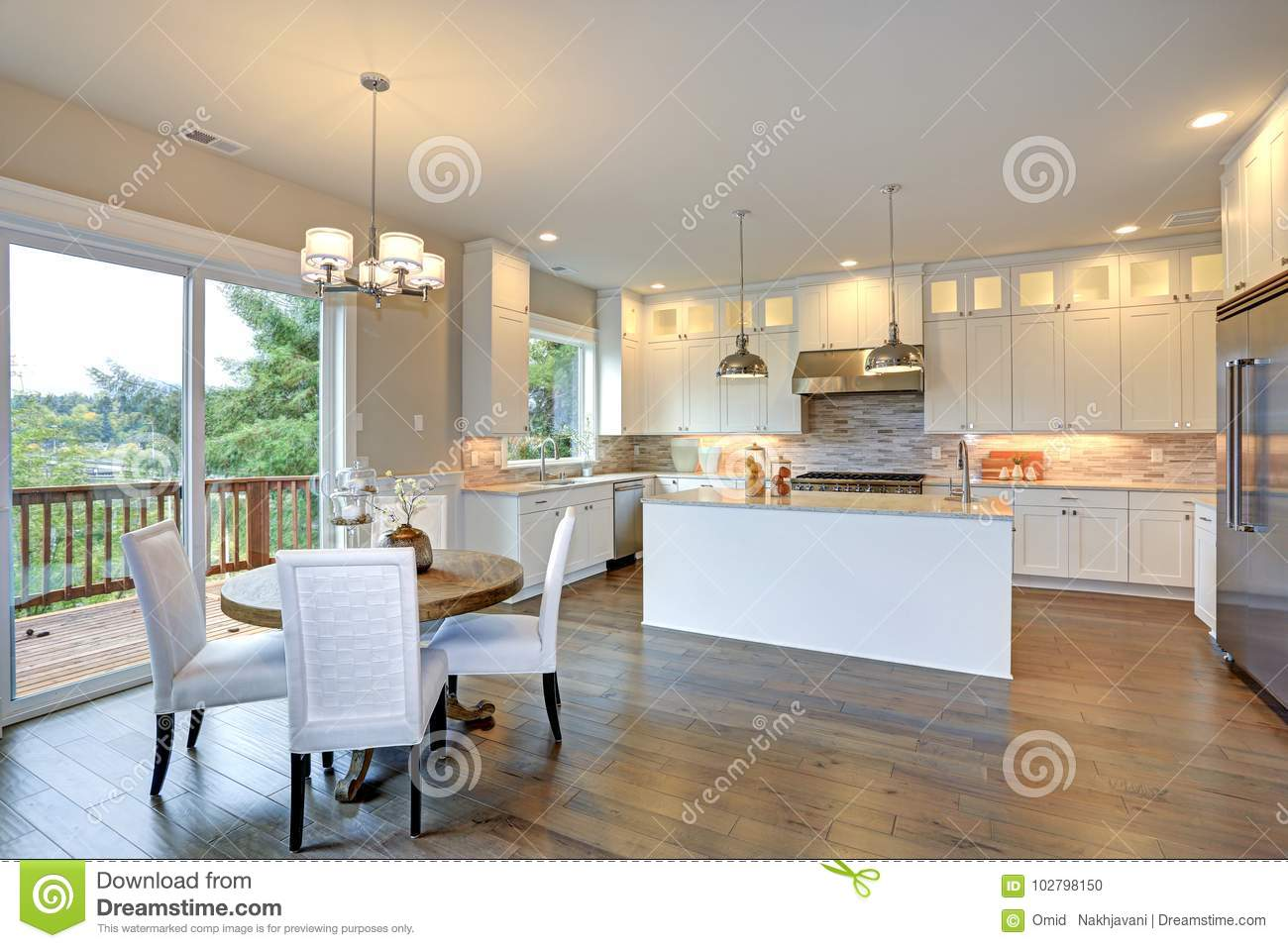 Luxury White Kitchen With Large Kitchen Island. Stock Photo ...