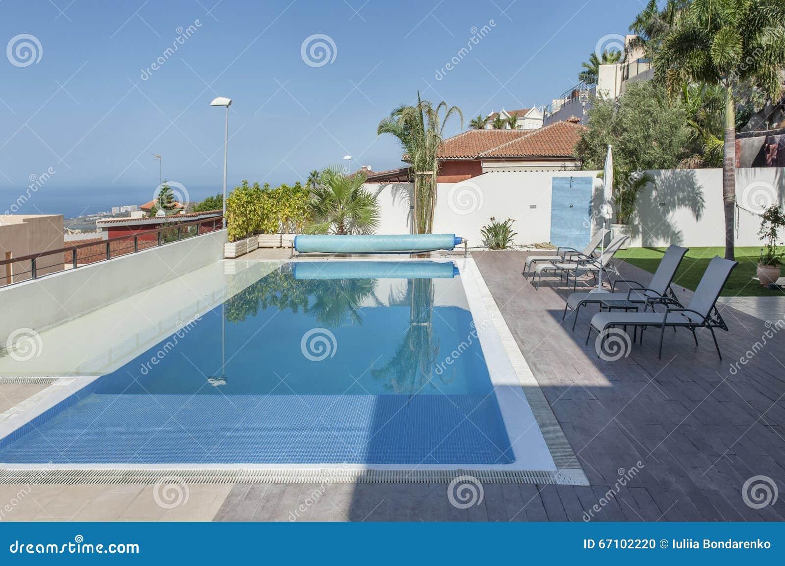Luxury white villa with swimming pool