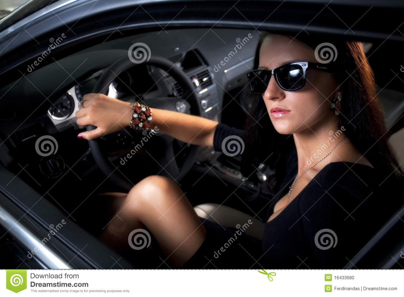 Luxury woman with long legs sitting in the car stock photo for Luxury women