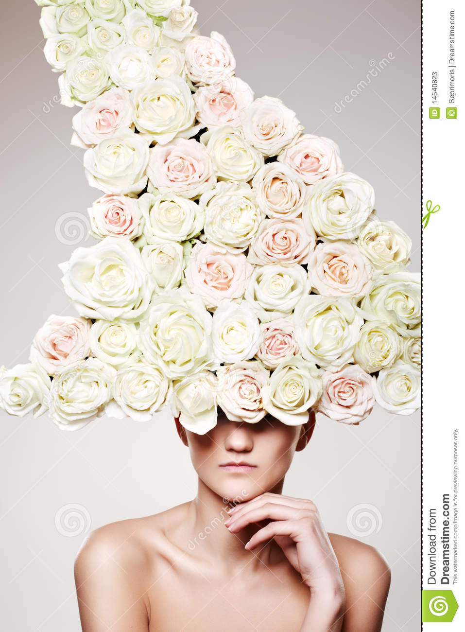 Luxury woman with a rose hat in fashion model pose