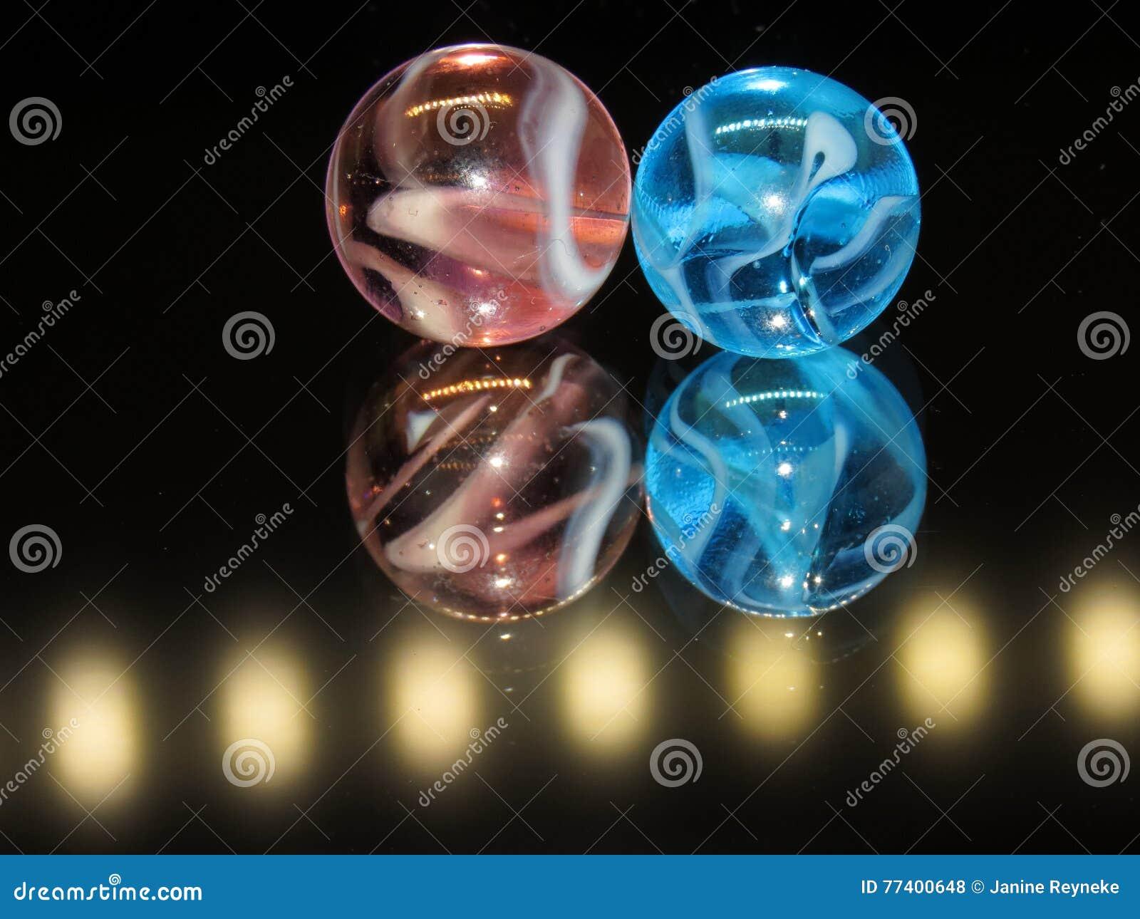 Luz - rosa e luz - mármores de vidro azuis