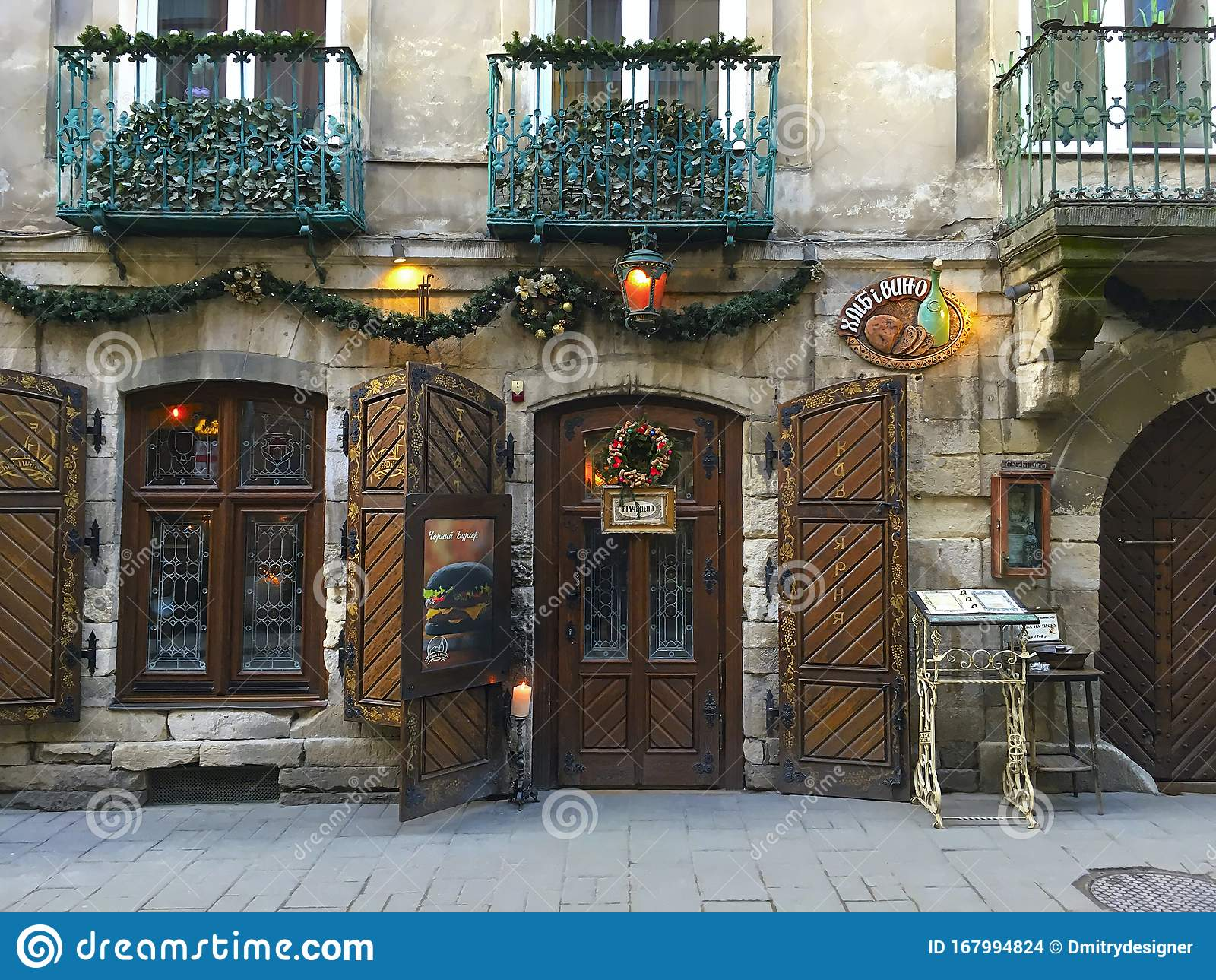 Beautiful Restaurant Exterior With Antique Massive Wooden Doors And Windows With A Christmas Wreath On The Door In The Center Of Editorial Stock Image Image Of Street Christmas 167994824