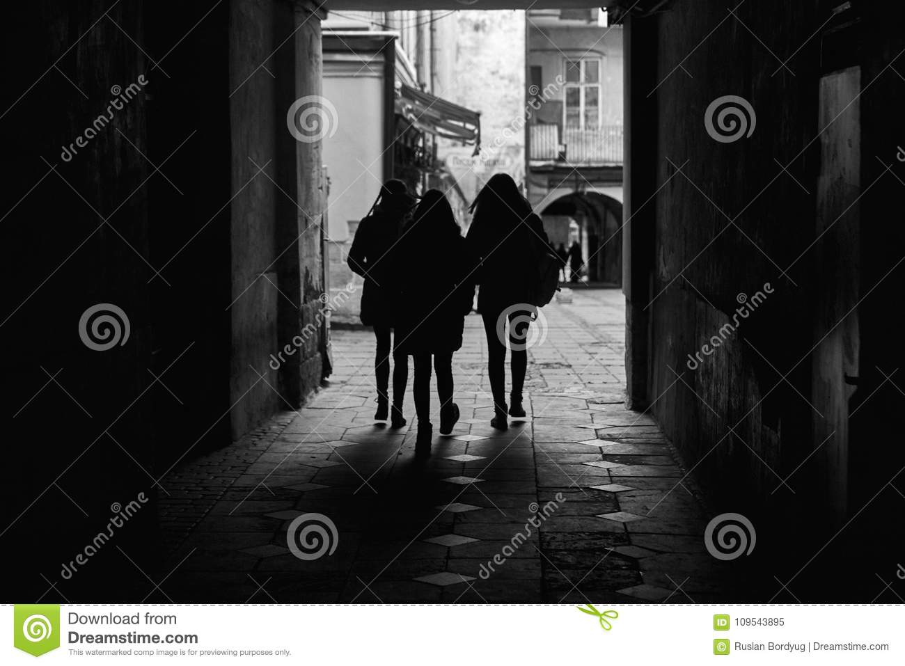 Silhouettes Of People Walking Through A Tunnel An Ancient City Black And White Photography