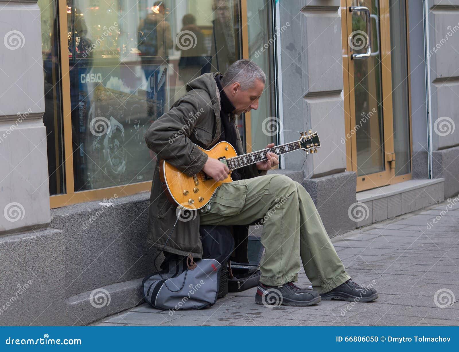 lviv ukraine october 18 2015 street musician playing an electric guitar editorial image. Black Bedroom Furniture Sets. Home Design Ideas