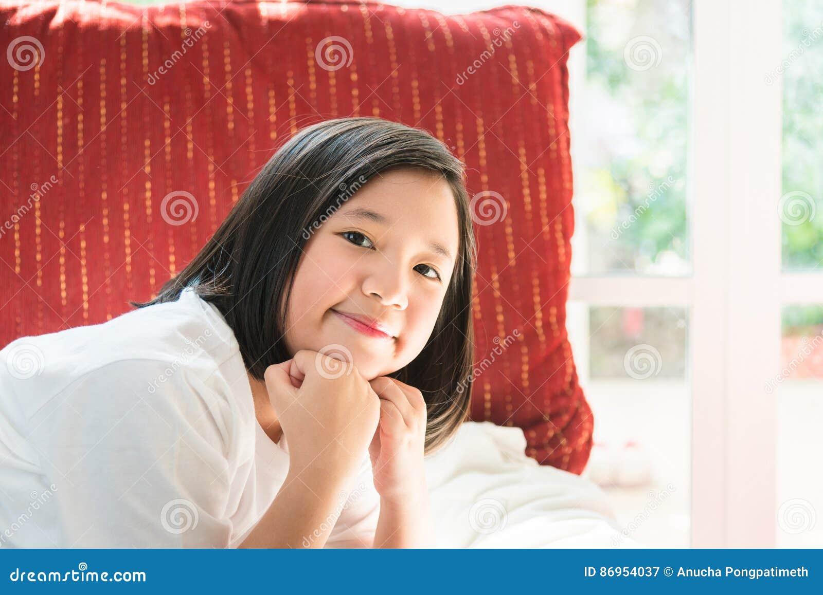 Lycklig asiatisk flicka