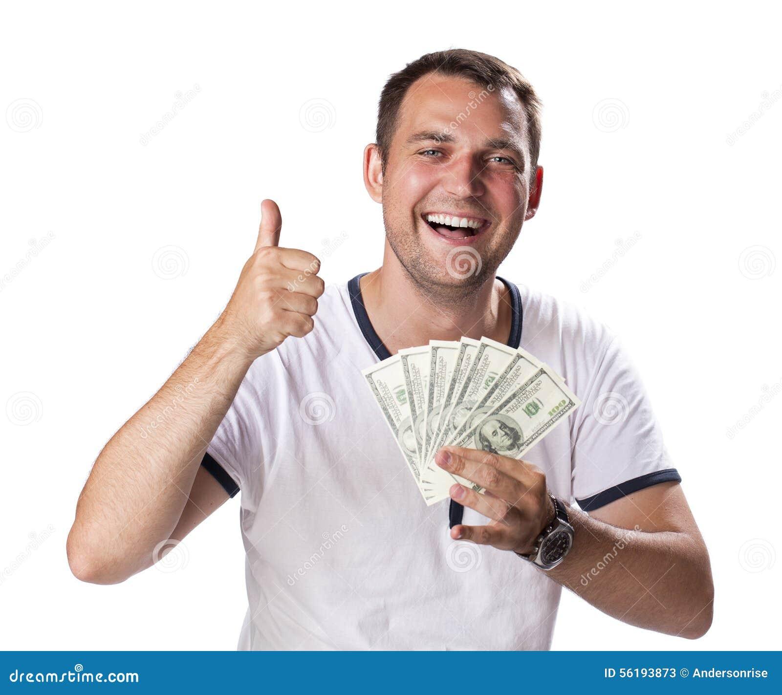 Lycklig ung man som rymmer en hög av kassa