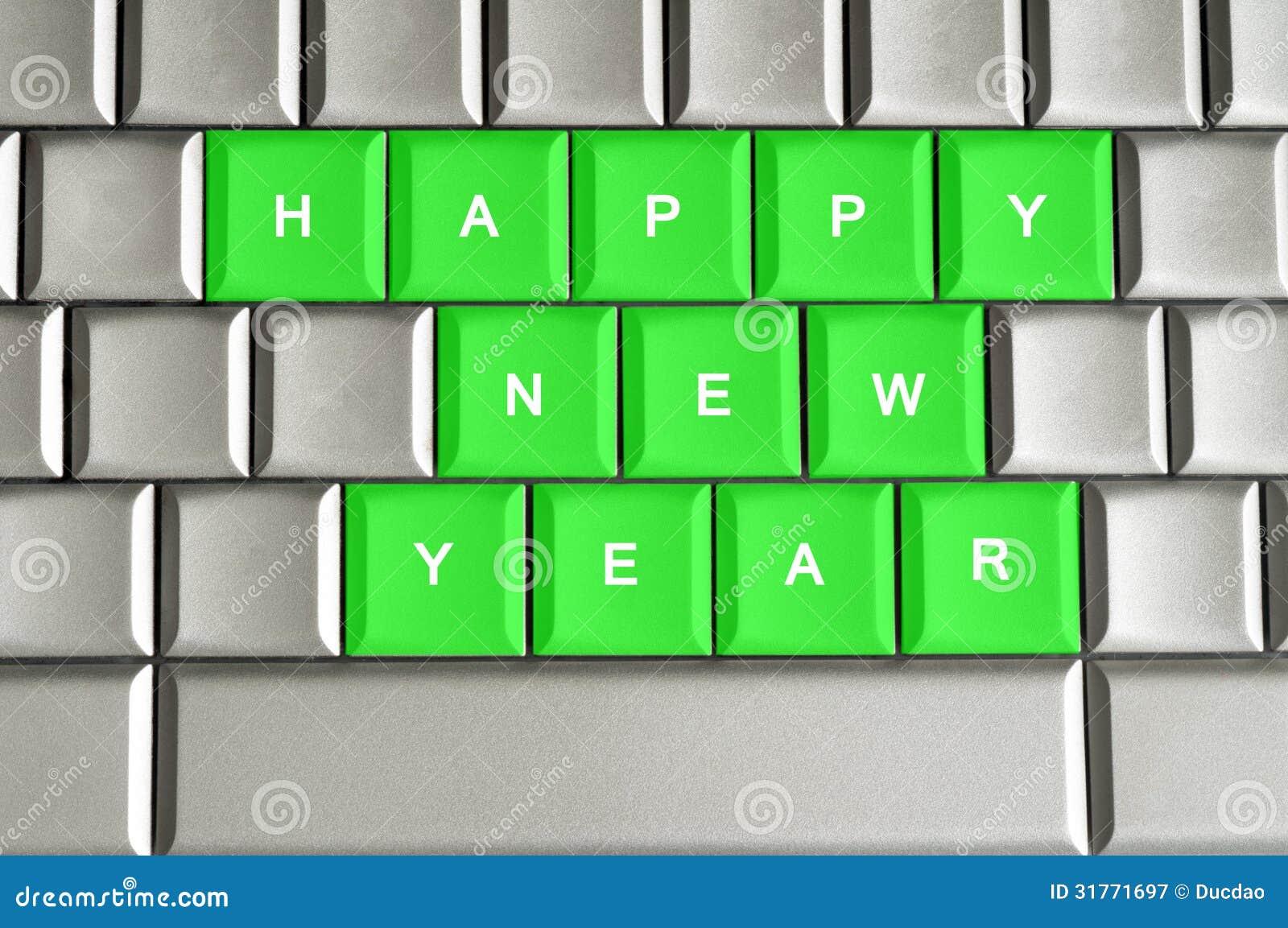 Lyckligt nytt år som stavas på ett metalliskt tangentbord