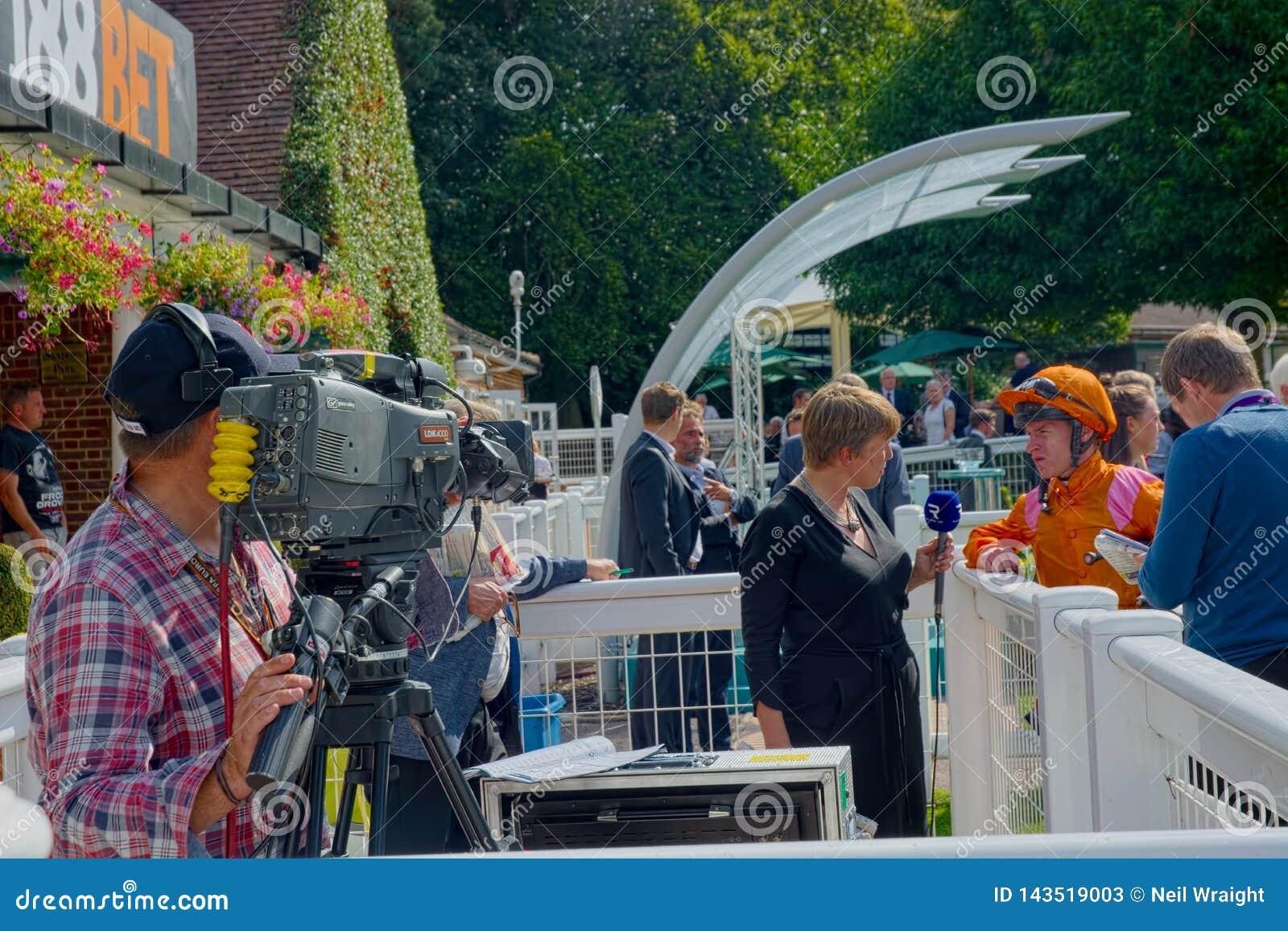 Lydia Hislop  UK Racing TV Presenter Interviewing A Jockey