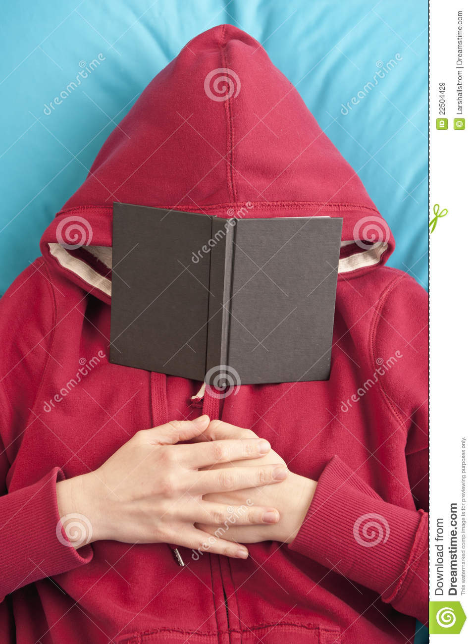 Book Covering Face : Lying down with book covering face royalty free stock