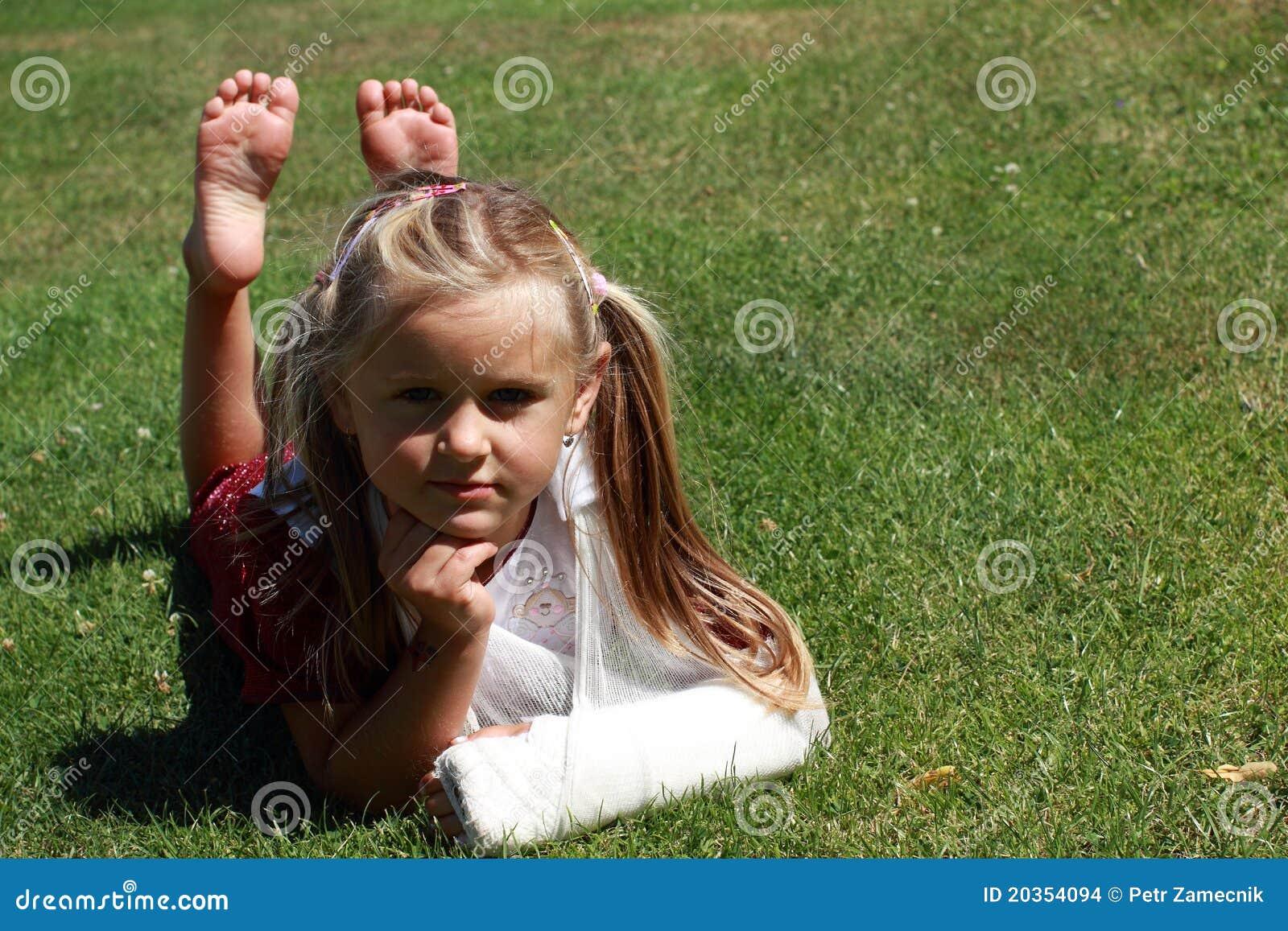 Lying girl with broken hand