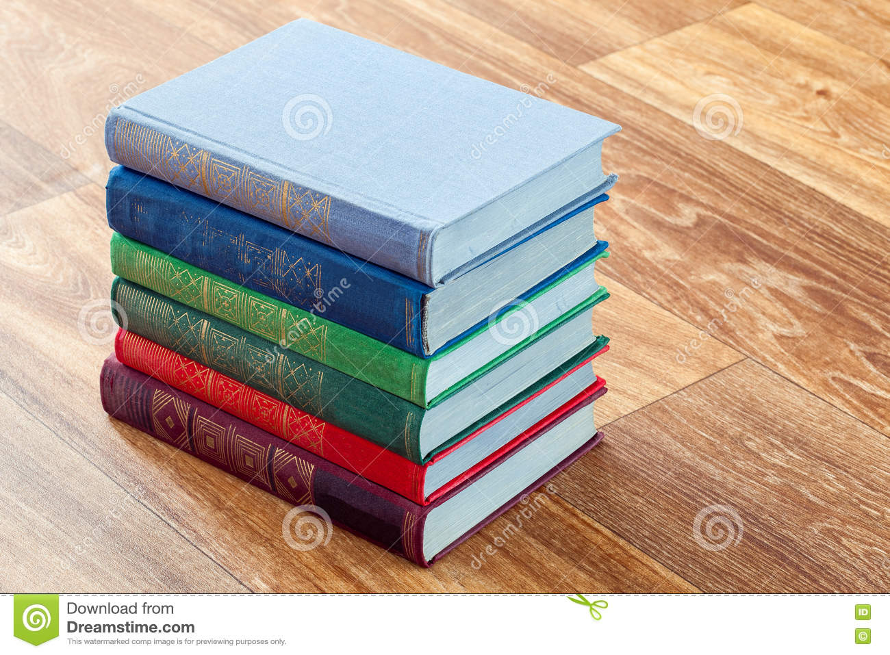 The Lying Multi-colored Books On A Wooden Table. Stock Image - Image ...
