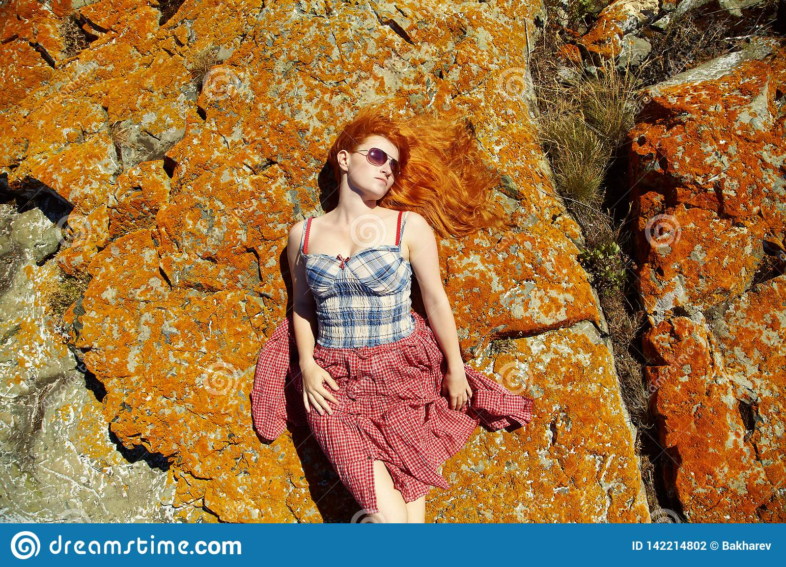 Lying redhead relaxing girl . stylish woman relaxation outdoor