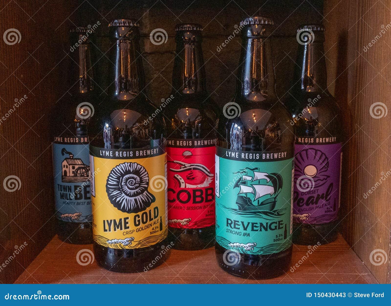 Lyme Regis, Dorset, England, February, 24, 2019: Bottles of craft beer lined up on a shelf at the Lyme Regis gBrewery