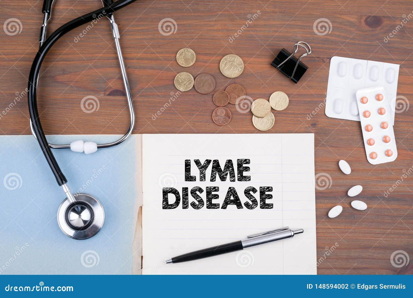 Lyme sjukdom Skrivbord f?r doktors` s med anteckningsboken